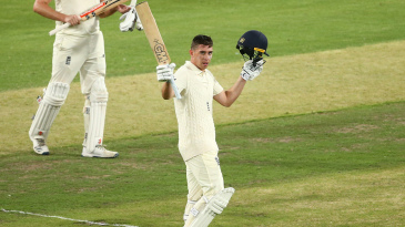 Dan Lawrence celebrates his hundred for England Lions at the MCG