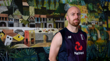 Jack Leach poses in front of a mural in Sri Lanka