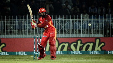 Shadab Khan lines up to hit the ball