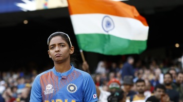Harmanpreet Kaur walks out for the toss