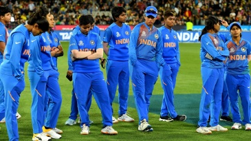 The Indian players wear a dejected look