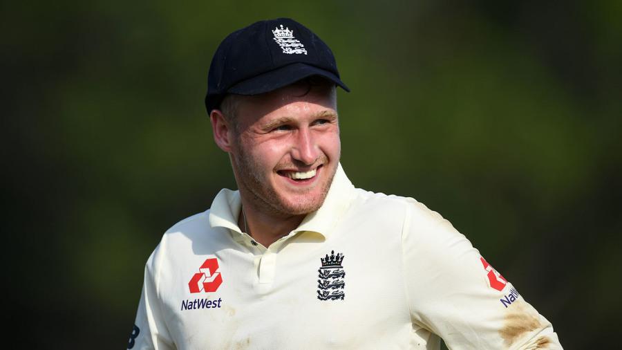 Matt Parkinson has a laugh during England's opening tour match in Sri Lanka