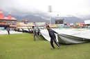 Covers being dragged on at Dharamsala after rain arrives, India v South Africa, 1st ODI, Dharamsala, March 12, 2020