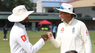 Captains Lahiru Thirimanne and Joe Root bump fists at the toss