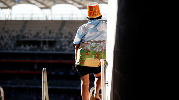 A fan watches the Big Bash game in Perth