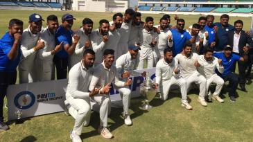 The Saurashtra players pose with the Ranji Trophy