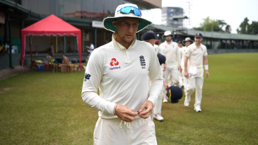 Joe Root leads his team off the field after the postponement of their Test series in Sri Lanka
