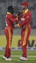 Wesley Madhevere celebrates with Sean Williams, Bangladesh v Zimbabwe, 1st T20I, Dhaka, March 9, 2020