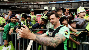 Dale Steyn takes a photo with young fans