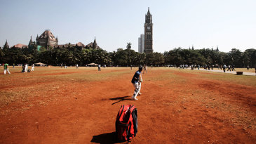 People play cricket at the Oval Maidan