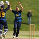 Issy Wong celebrates a wicket for Warwickshire Women