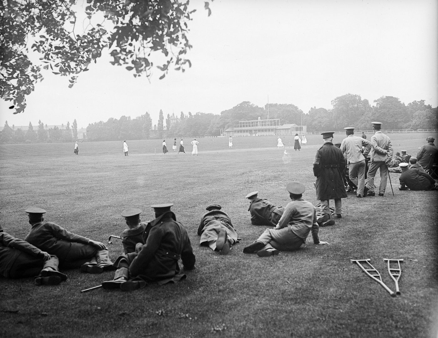 Convalescing soldiers watch a ladies' cricket match at Hurlingham Park in London, in 1917