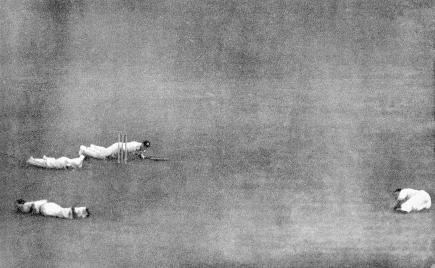 Army batsman Jack Robertson, RAF wicketkeeper Andy Wilson, and fielders Bill Edrich (bottom left) and Austin Matthews drop to the ground as a V1 flying bomb buzzes past Lord's mid-match