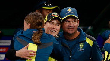 Matthew Mott with Ellyse Perry and Tayla Vlaeminck