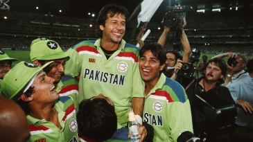 His team-mates hoist Imran Khan on their shoulders