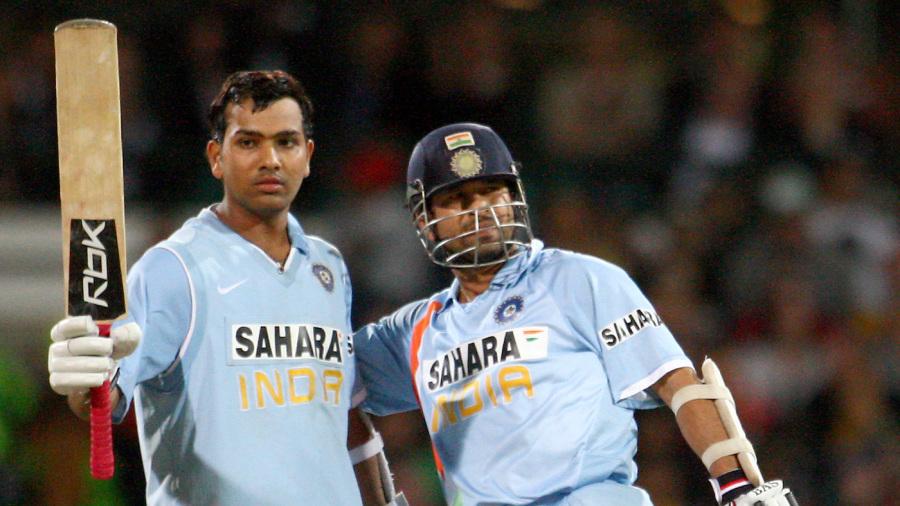 Rohit Sharma celebrates his half-century with Sachin Tendulkar