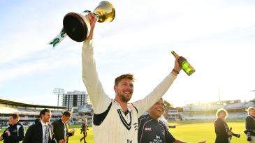 Ollie Rayner holds the County Championship trophy aloft in 2016