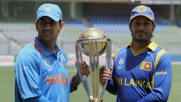 MS Dhoni and Kumar Sangakkara pose with the 2011 World Cup trophy