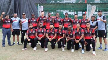 The Singapore 2019 T20I team, with mentor Chetan Suryawanshi (kneeling, third from left)