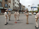 Joginder Sharma, former India player, now a police officer, talks to colleagues, Hisar, Haryana, April 2020