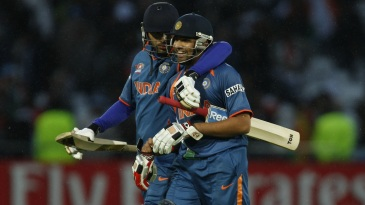Yuvraj Singh and Rohit Sharma walk back after India's win