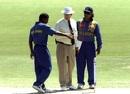 Muttiah Muralitharan and Arjuna Ranatunga argue with umpire Ross Emerson after the no-ball incident, England v Sri Lanka, Carlton & United Series, 23 January, 1999, Adelaide