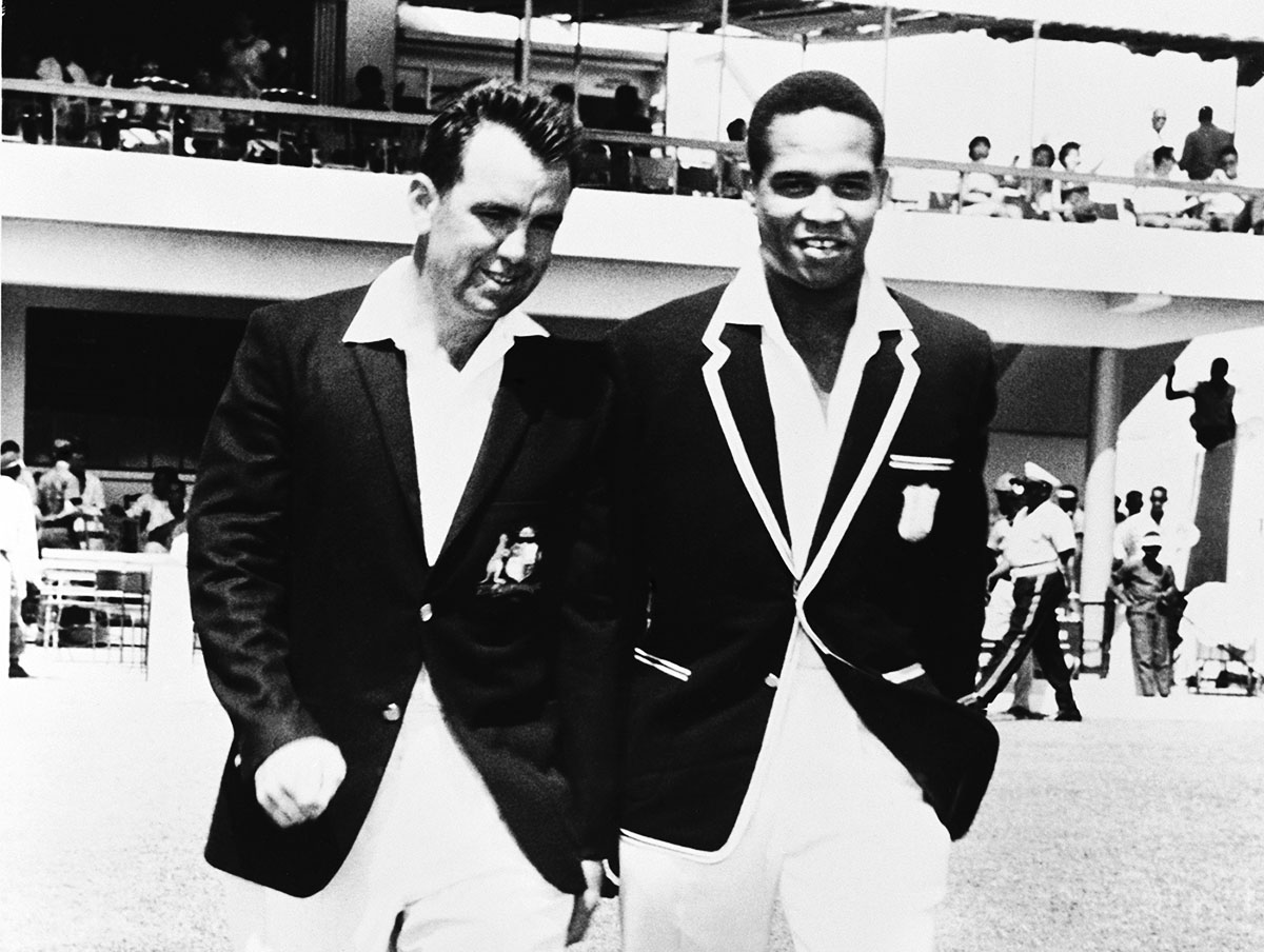 The two captains, Bob Simpson and Garry Sobers, walk out for the toss