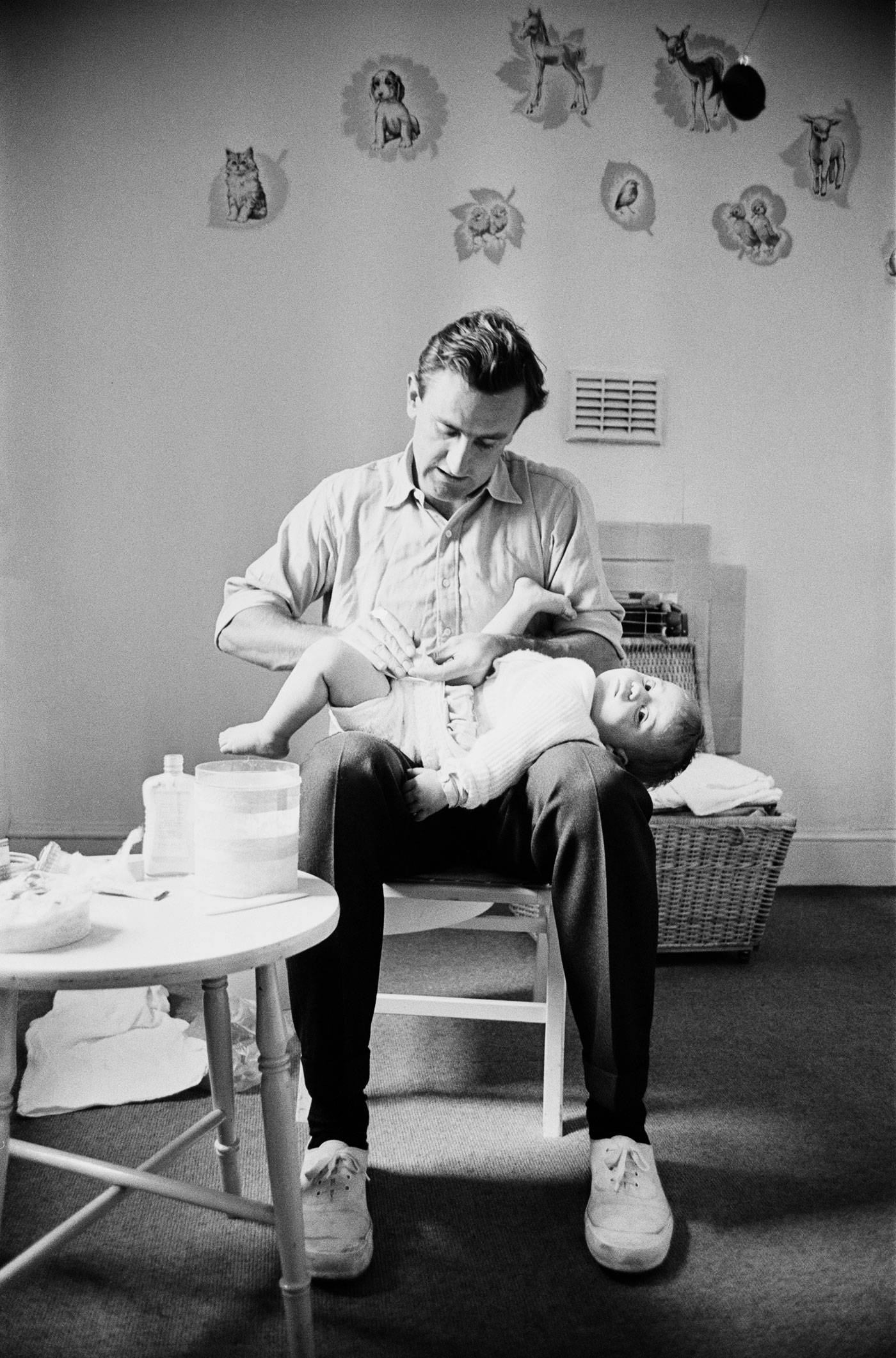 England captain Ted Dexter changes his son's nappy at home, 1963