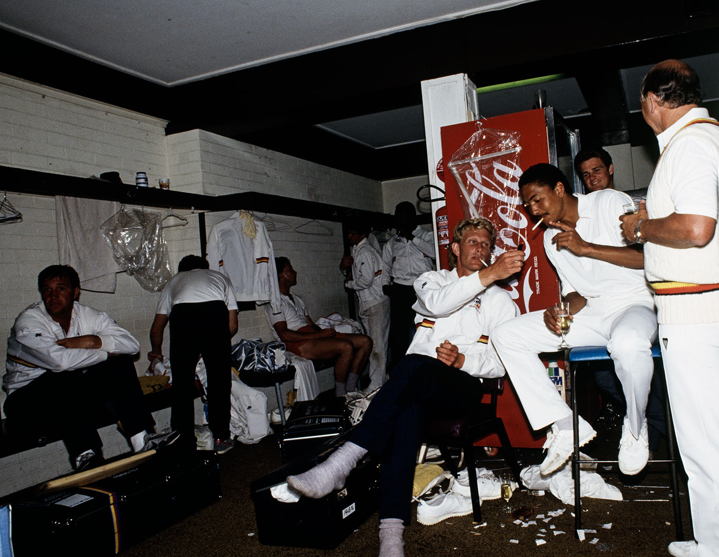 Graham Dilley lights a cigarette for Phil DeFreitas after England's seven-wicket win in the Brisbane Test, 1986