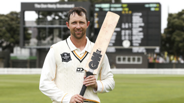 Devon Conway poses after his triple-century
