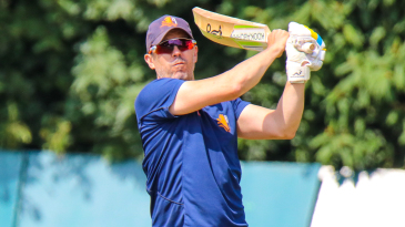 Netherlands coach Ryan Campbell hits a skier during fielding practice