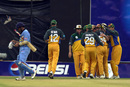 Australia celebrate as Sachin Tendulkar walks back, India v Australia, ICC Knockout 2000