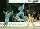 Robin Singh celebrates the wicket of Damien Martyn, India v Australia, ICC Knockout 2000