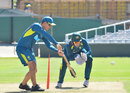 Justin Langer works with Alex Carey during training, Cape Town, February 25, 2020