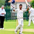 Virat Singh raises his bat after getting a hundred