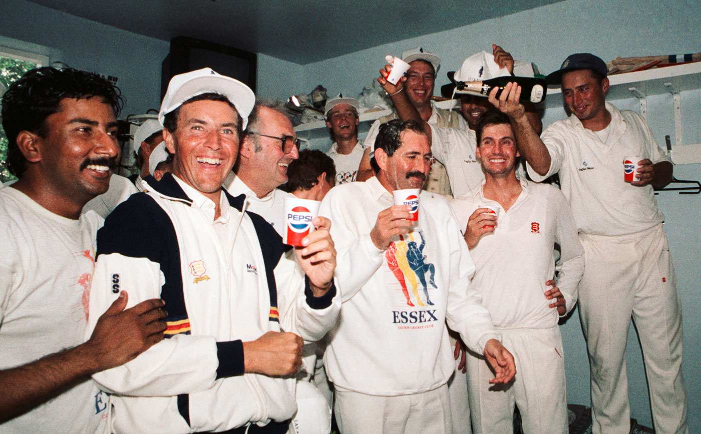 Graham Gooch celebrates Essex's 1991 County Championship win with his team-mates in the Chelmsford dressing room