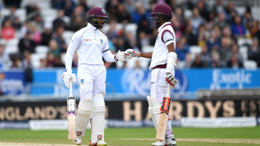 Shai Hope offers Kraigg Brathwaite a fist bump