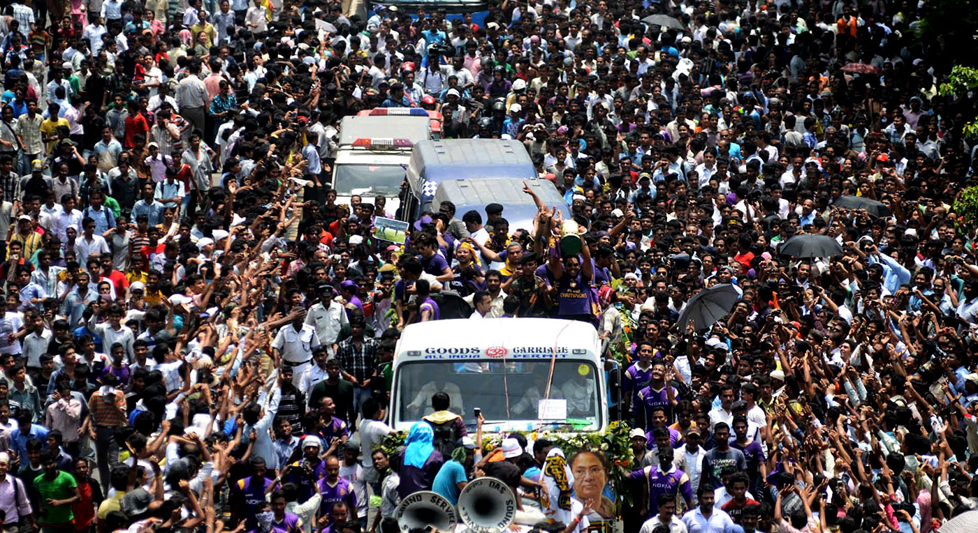 Kolkata Knight Riders ride in a procession across the streets of Kolkata, greeted by fans