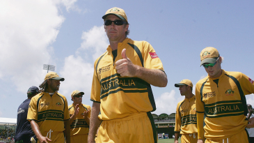 Glenn McGrath leads Australia off the field after cutting through South Africa