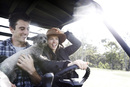 Pat Cummins, his fiancé Becky Boston and their dog Norman ride on their farm buggy while in isolation, Southern Highlands, New South Wales, Australia, April 13, 2020