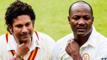 Sachin Tendulkar and Brian Lara sign autographs for fans