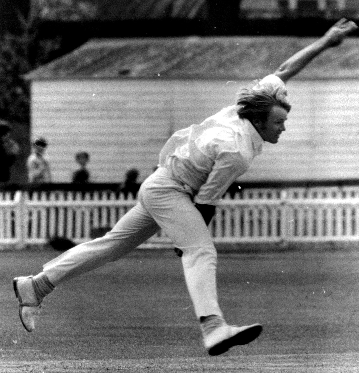 Wind in his hair, hostility in his stride, Mike Procter steams in to bowl