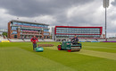 Lancashire's groundstaff work on the pitch at Emirates Old Trafford, May 21, 2020