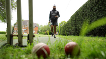 Amar Virdi, the Surrey and England Lions spinner, trains at his home