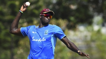 Jason Holder takes part in a fielding drill