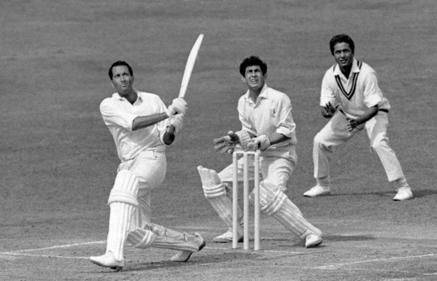 Basil D'Oliveira lofts the ball to the boundary, watched by Pakistan wicketkeeper Wasim Bar