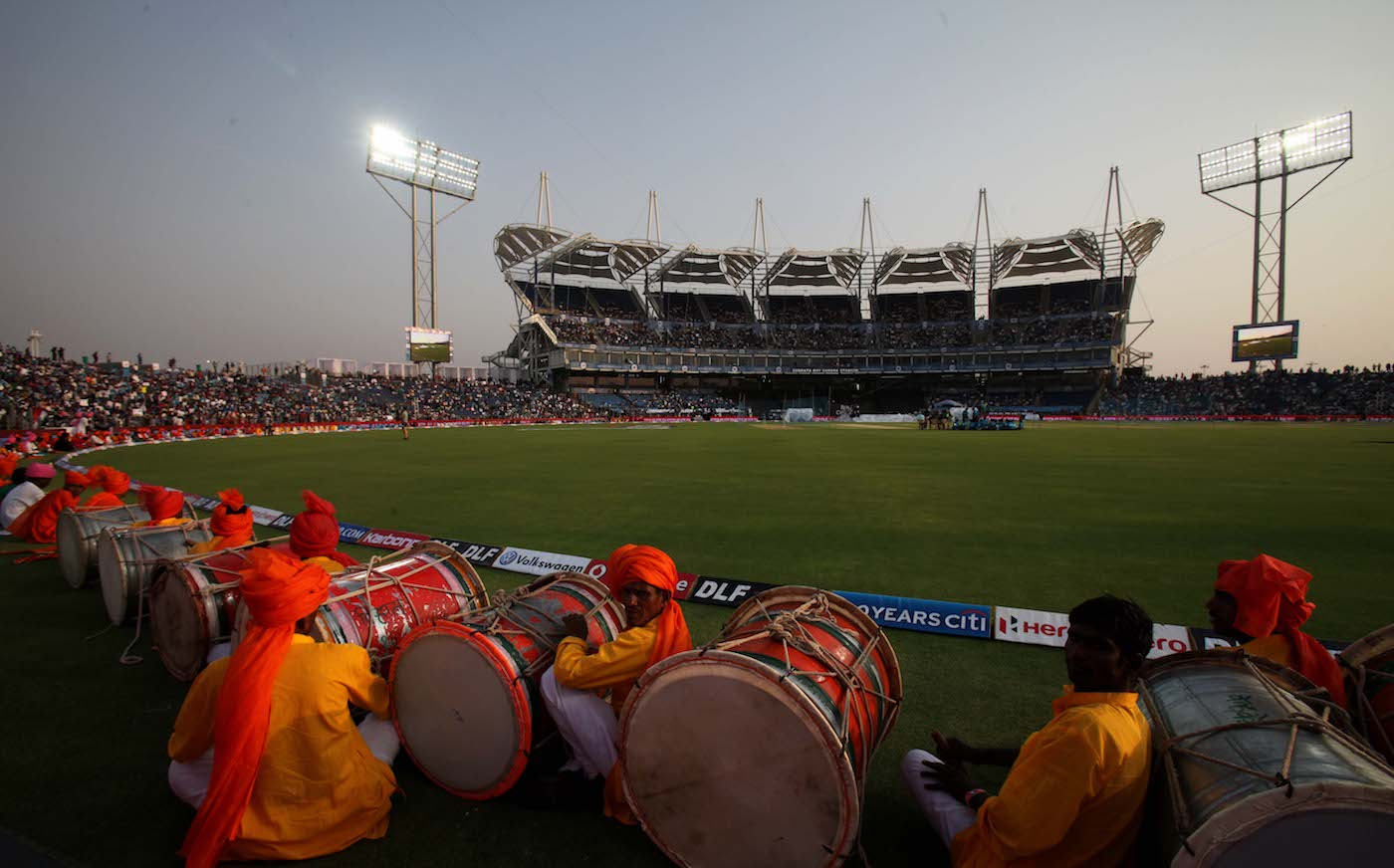 A drum crew waits to perform at the inauguration of the MCA stadium and its first IPL match