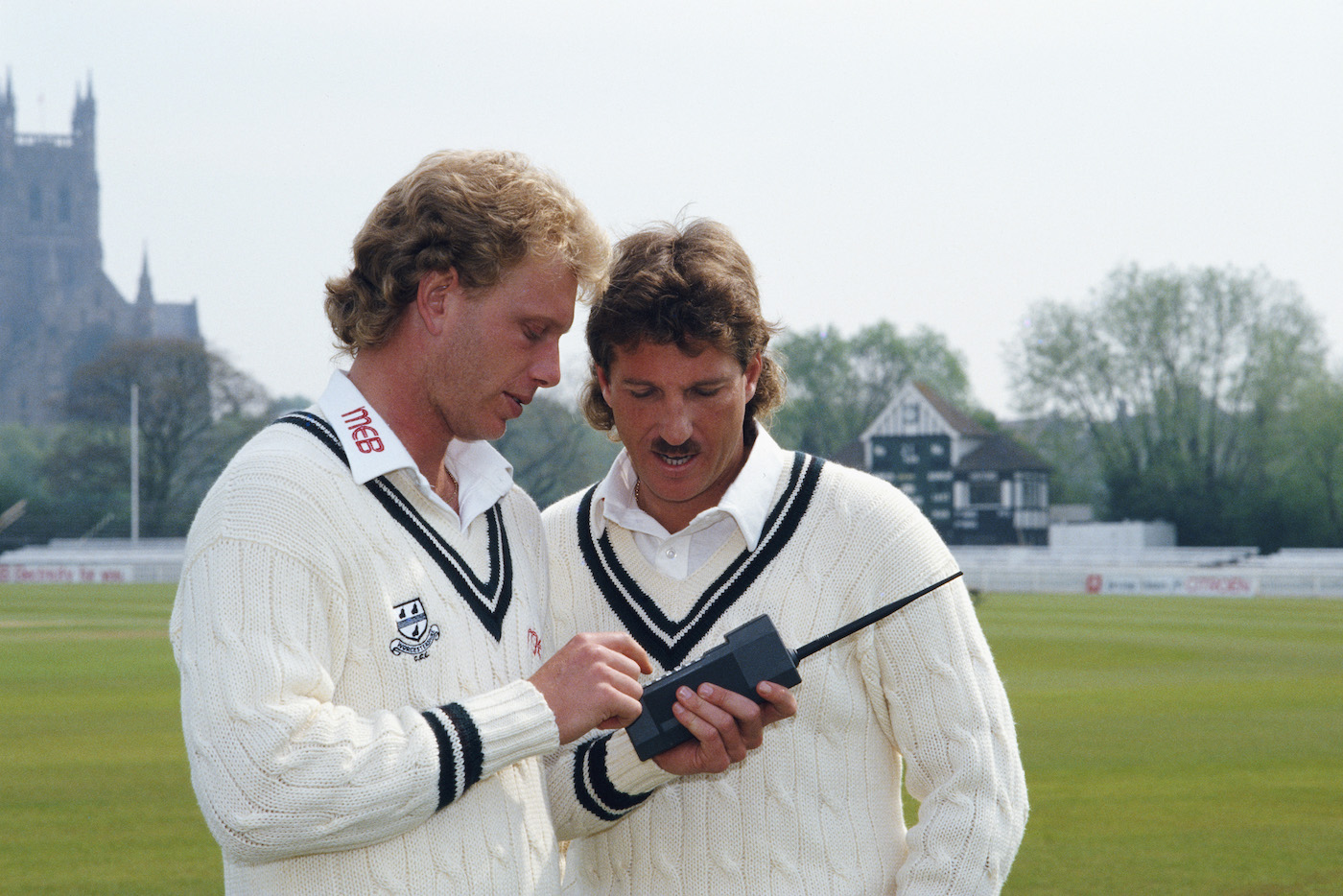Graham Dilley presumably teaching Botham how to use a mobile phone to terrorise umpires and batsmen