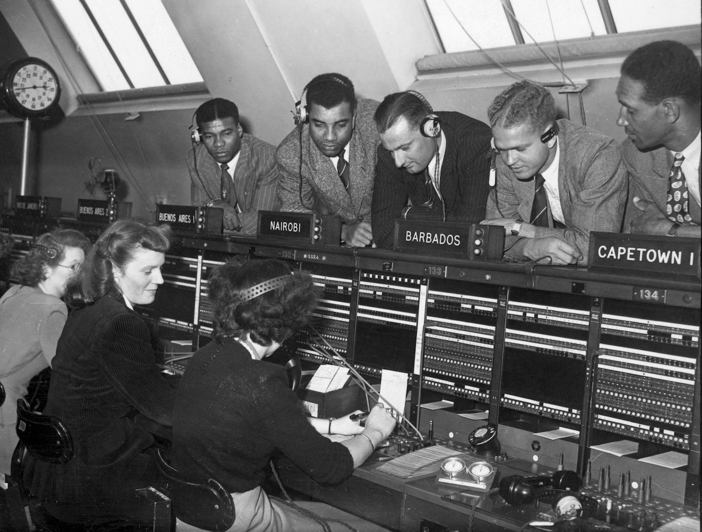 Everton Weekes, Clyde Walcott, John Goddard, Hines Johnson and Foffie Williams (from left) get a crash course in cross-country dialling at the International Exchange in London, during their 1950 tour of England