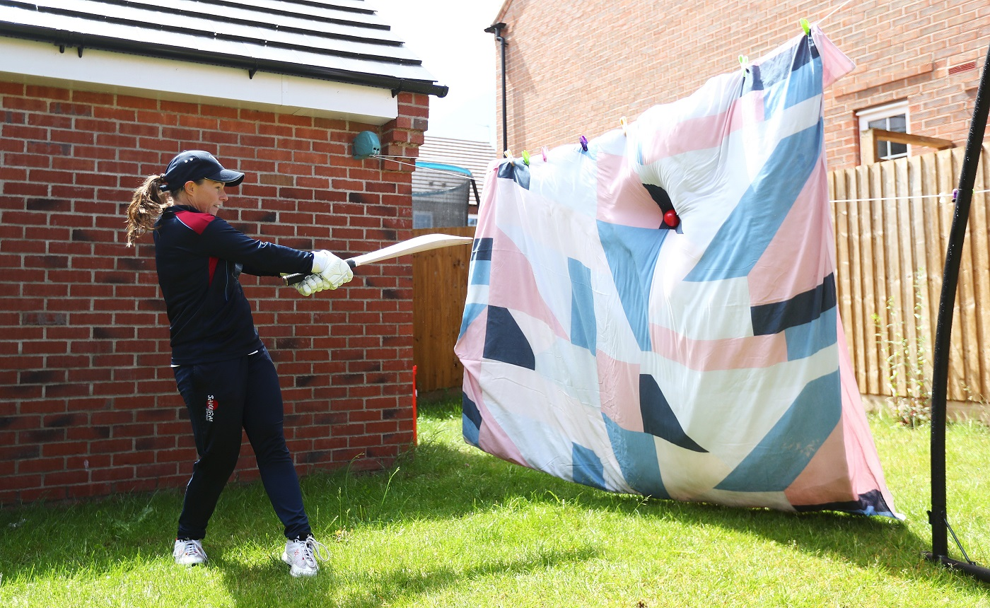 England batter Tammy Beaumont makes do with a makeshift net in her garden